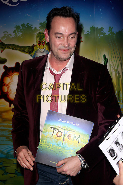 "CRAIG REVEL HORWOOD.The Cirque du Soleil ""Totem"" press Tour, Royal Albert Hall, Kensignton Gore, London, England..January 5th, 2011.half length burgundy maroon velvet jacket tie pink.CAP/AH.©Adam Houghton/Capital Pictures."