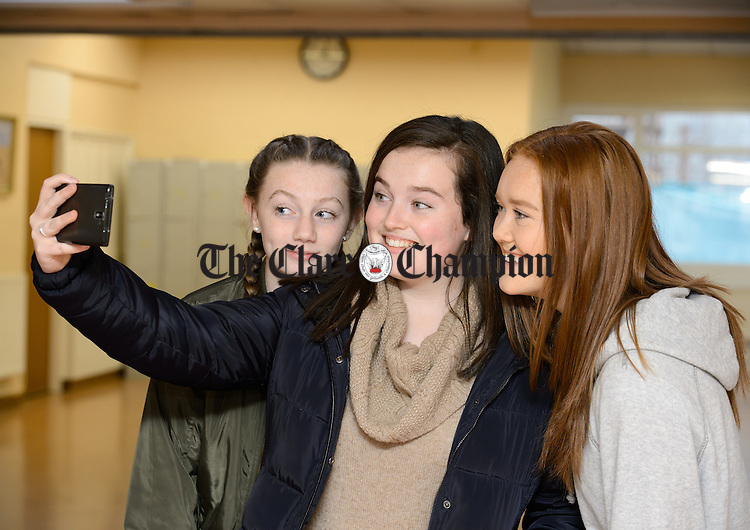 Julita Fox, Rebecca Mc Evoy and Sasha Mc Gettrick take a selfie while attending an exhibition of old archive photographs as part of the 50th anniversary celebrations at St Patrick's Comprehensive school, Shannon. Photograph by John Kelly.
