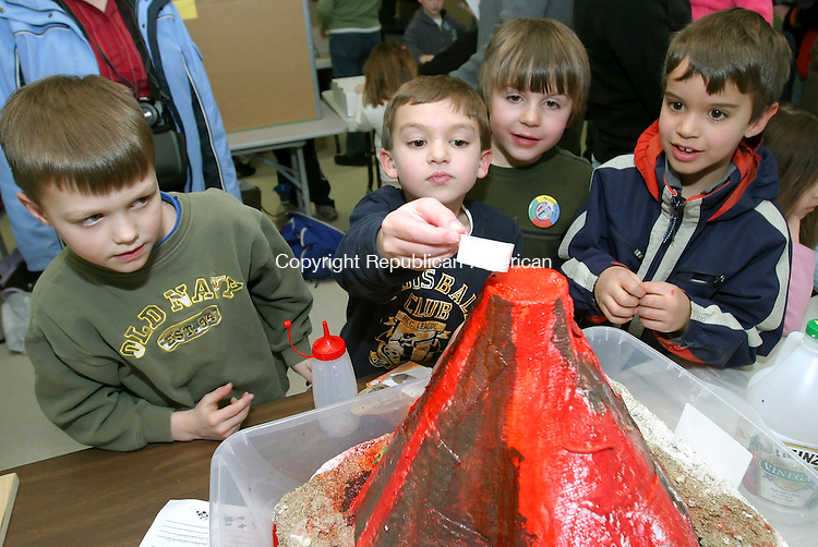 BETHLEHEM, CT-- 21 FEBRUARY 2008--022108JS06-Ben Donato, second from left, a first grader at Bethlehem Elementary School, prepares to pour baking soda inside a vinegar solution as he demonstrates his volcano to classmates Nick Sordi, left, Andrew Ray, and Michael Papanek during the schools science fair held at the school on Thursday. <br /> Jim Shannon/Republican-American