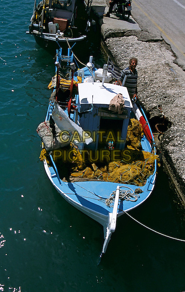 Fisherman and fishing boat at quayside, Lixouri, Kefalonia, Greece
