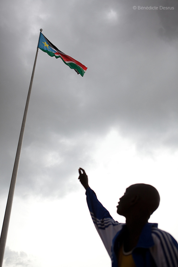 july 19, 2011 - Juba, Republic of South Sudan - A South Sudanese man points at the flag of The Republic of South Sudan at the Dr John Garang Mausoleum in the capital city of Juba. Tens of thousands of South Sudaneses celebrated national independence on july 9, 2011, but whether statehood will resolve issues of identity after a decades-long war remains to be seen. The Republic of South Sudan became a United Nations member state and the world's 193rd country. Photo credit: Benedicte Desrus