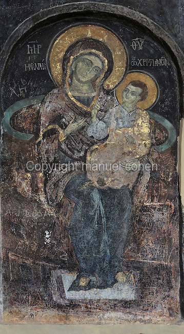 Fresco of Virgin and child which has been restored, on the wall of the portico of the Dormition of Saint Mary Cathedral Church, or Kisha Katedrale Fjetja e Shen Marise, built 1699, Voskopoje, Korce, Albania. The church contains frescoes by Theodor Anagnost and Sterian from Agrapha in Greece, and the large icons in the iconostasis were painted 1703 by Constantine Lemoronachos. Picture by Manuel Cohen