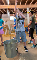 Grade four students of Holy Trinity School in Sarnia were introduced to different aspects of farm life as part of an Agriculture in the Classroom held at the Canatara Park Animal Farm. Heath Hillier, 9 tries his hand at hoisting a bucket of sand using brut strength and  pulleys.