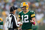 Green Bay Packers quarterback Aaron Rodgers (12) talks to side judge Larry Rose during a review of a touchdown run during a Week 4 NFL football game against the Denver Broncos on October 2, 2011 in Green Bay, Wisconsin. The Packers won 49-23. (AP Photo/David Stluka)