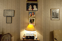 Family's pictures on the furniture and honors on the wall in Mohamed Hamed's apartment in Cairo. July 2012, Egypt.