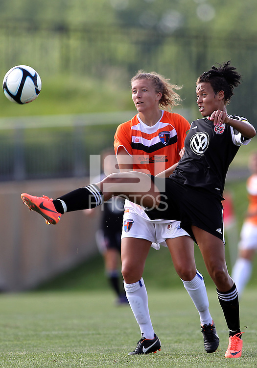 BOYDS, MARYLAND - July 22, 2012:  Lianne Sanderson (10) of DC United Women knocks the ball away from Kelsey Fenix (10) of the Charlotte Lady Eagles during the W League Eastern Conference Championship match at Maryland Soccerplex, in Boyds, Maryland on July 22. DC United Women won 3-0.