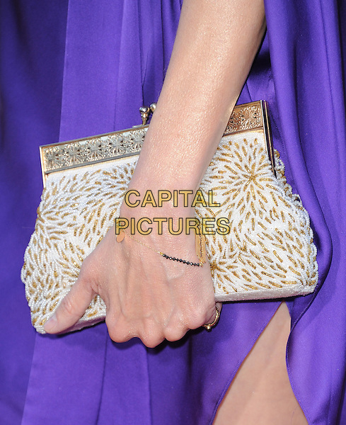 Mary-Louise Parker's bag.The World Premiere of 'Savages' held at The Grauman's Chinese Theatre in Hollywood, California, USA..June 25th, 2012.detail purple hand bracelet white gold beads beaded clutch bag.CAP/RKE/DVS.©DVS/RockinExposures/Capital Pictures.