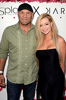 LOS ANGELES - AUG 21:  Randy Couture, Mindy Robinson at the Karina Collection with LA Splash Cosmetics Launch at the Sofitel Los Angeles on August 21, 2017 in Beverly Hills, CA