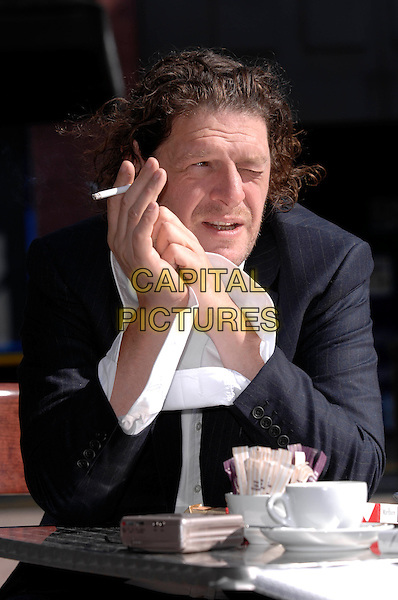 MARCO PIERRE WHITE.Pictured outside his new restaurant in Stamford Bridge, Chelsea, London, England..September 18th, 2007.chef half length stubble facial hair cigarette smoking blue black jacket .CAP/DH.©David Hitchens/Capital Pictures.