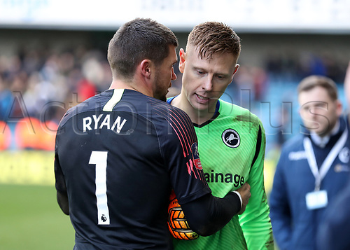 17th March 2019, The Den, London, England; The Emirates FA Cup, quarter final, Millwall versus Brighton and Hove Albion; Goalkeeper Matthew Ryan of Brighton & Hove Albion consoles a dejected Goalkeeper David Martin of Millwall after full time as Brighton and Hove Albion beat Millwall 5-4 in the penalty shoot out to book there place in the Semi Final