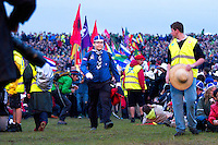 Jamboree Flag Master Henrik (Finland) arriving to opening ceremony with flags from all participant countries.