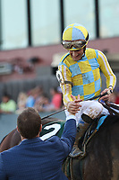 HOT SPRINGS, AR - April 15: Jockey Julien Leparoux and Norm Casse shake hands after Classic Empire's victory in the Arkansas Derby at Oaklawn Park on April 15, 2017 in Hot Springs, AR. (Photo by Ciara Bowen/Eclipse Sportswire/Getty Images)