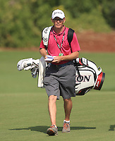 Dermot Byrne on the bag for Shane Lowry (IRL) walking down the 10th during the preview for the DP World Tour Championship at the Earth course,  Jumeirah Golf Estates in Dubai, UAE,  18/11/2015.<br /> Picture: Golffile | Thos Caffrey<br /> <br /> All photo usage must carry mandatory copyright credit (© Golffile | Thos Caffrey)