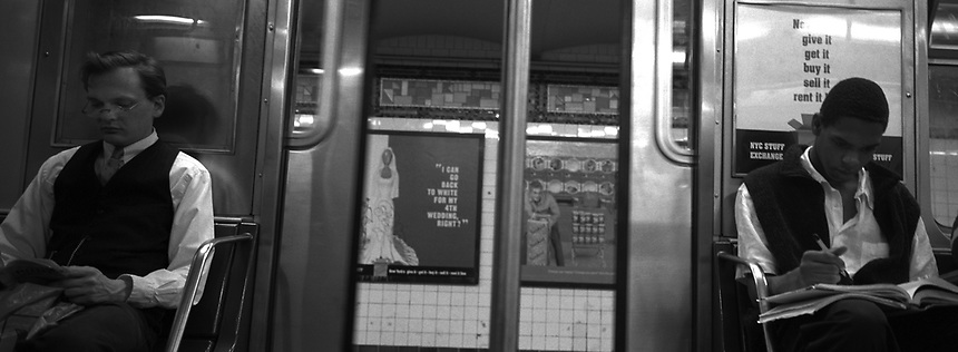 Students study on the subway. Subway series shot in New York between the years 1998 and 2001
