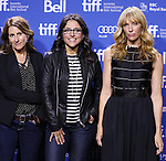 """Nicole Holofcener, Julia Louis-Dreyfus and  Toni Collette attending the 2013 Tiff Film Festival Photo Call for """"Enough Said""""  at the Tiff Lightbox  on September 8, 2013 in Toronto, Canada."""