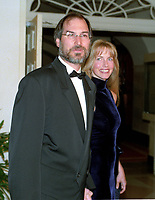 Apple founder Steve Jobs and Laurene Powell Jobs