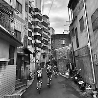 Cycling through the back alleys of Taipei, Taiwan.