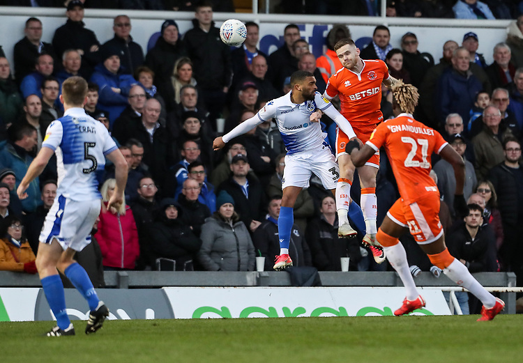 Blackpool's Oliver Turton competing with Bristol Rovers' Tareiq Holmes-Dennis <br /> <br /> Photographer Andrew Kearns/CameraSport<br /> <br /> The EFL Sky Bet League Two - Bristol Rovers v Blackpool - Saturday 2nd March 2019 - Memorial Stadium - Bristol<br /> <br /> World Copyright © 2019 CameraSport. All rights reserved. 43 Linden Ave. Countesthorpe. Leicester. England. LE8 5PG - Tel: +44 (0) 116 277 4147 - admin@camerasport.com - www.camerasport.com