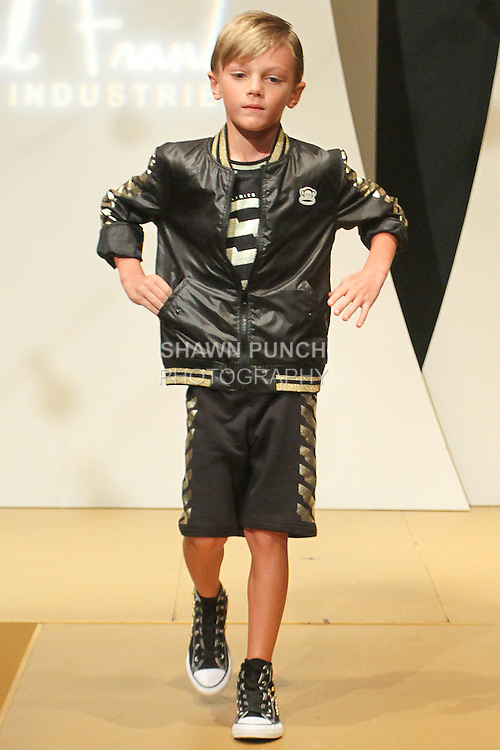 """Model walks runway in an outfit for the debut of the Paul Frank Industries Children's Spring Summer 2016 """"Circus Jumble"""" collection during New York Fashion Week Spring 2016."""