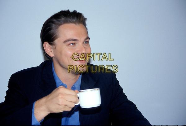 LEONARDO DICAPRIO.headshot, portrait, goatee, stubble, facial hair, smiling, drinking, coffee cup, mug.www.capitalpictures.com.sales@capitalpictures.com.© Capital Pictures.