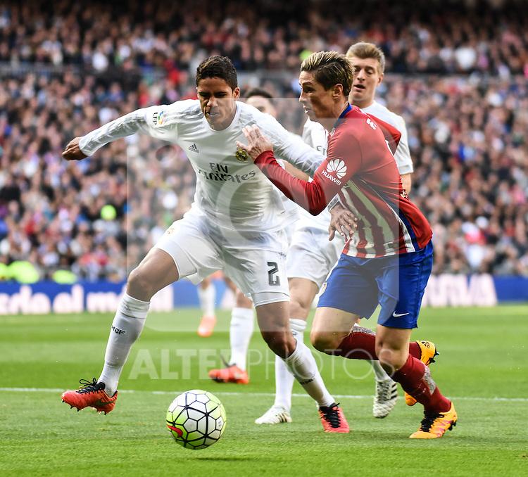 Real Madrid´s Raphael Varane and Atletico de Madrid´s Fernando Torres during 2015/16 La Liga match between Real Madrid and Atletico de Madrid at Santiago Bernabeu stadium in Madrid, Spain. February 27, 2016. (ALTERPHOTOS/Javier Comos)