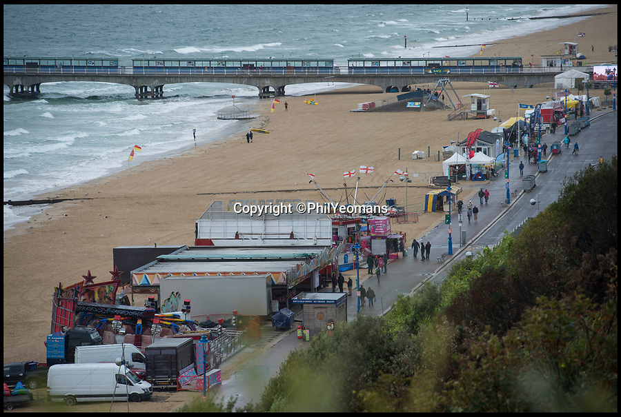 BNPS.co.uk (01202 558833)<br /> Pic: PhilYeomans/BNPS<br /> <br /> Rain stops play...The Bournemouth Air Festival is cancelled today as rain and winds sweep in.<br /> <br /> 500,000 crowded into Bournemouth yesterday for the south coast resort's annual air festival.<br /> <br /> It was difficult to see the sand on the beach as holidaymakers crowded onto the seven miles of seafront to watch the Red Arrows.