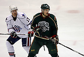 February 24th 2008:  Ryan Hamilton (12) of the Houston Aeros is defended by Dan Collins (17) during a game vs. the Rochester Amerks at Blue Cross Arena at the War Memorial in Rochester, NY.  The Aeros defeated the Amerks 4-0.   Photo copyright Mike Janes Photography 2008