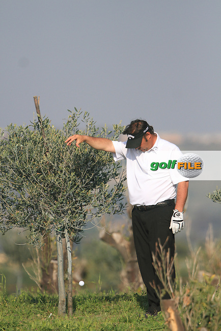 Emanuele Canonica (ITA) takes a drop after seeking referees assistance on the 15th on Day 1 of the 2012 Sicilian Open at Verdura Golf and Spa Resort, Sicily, Italy...(Photo Jenny Matthews/www.golffile.ie)