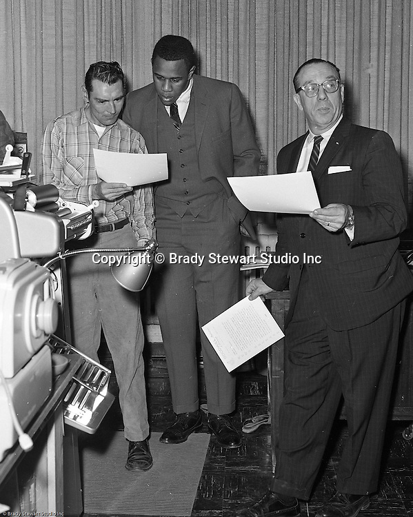 Pittsburgh PA:  Willie Stargell getting a tour of the Goodwill Industries facility - 1966.  Willie and a many other Pittsburgh Pirates were very involved in the community supporting charitable causes.<br /> In 1966, Goodwill Industries was part of the United Fund Community Chest Agency which eventually became the United Way of Allegheny County in 1974. Goodwill Industries provides a broad array of employment-related education and workforce development programs and services for people with physical and intellectual disabilities and other barriers to employment.