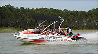 BNPS.co.uk (01202 558833)<br /> Pic: Sealver/BNPS<br /> <br /> Is it a boat-Is it a jetski....Its both!<br /> <br /> A futuristic-looking boat that is solely powered by a jetski has hit the market and it could be yours for less than &pound;8,000.<br /> <br /> The Sealver Wave Boat 444 works by allowing most mainstream jetskis to connect to the rear end, both powering and steering the boat. The jetski can then be detached at your leisure with the 14.5ft long vessel left anchored in the sea. <br /> <br /> The process of attaching and detaching the ski is quick and simple with customised adaptor kits allowing the likes of Yamaha, Kawasaki and Sea-Doo to hook up easily. <br /> <br /> Depending on the jetski powering it, the 617.2lb Wave Boat can reach speeds of 50 knots - the equivalent of 57mph.