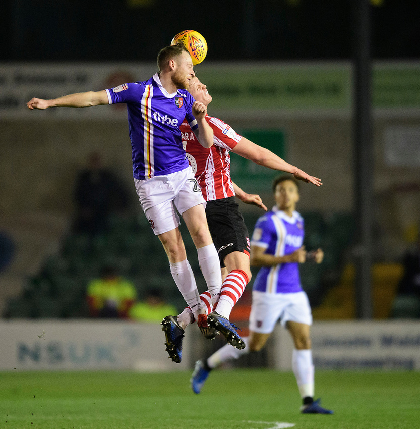 Lincoln City's Mark O'Hara vies for possession with Exeter City's Jake Taylor<br /> <br /> Photographer Chris Vaughan/CameraSport<br /> <br /> The EFL Sky Bet League Two - Lincoln City v Exeter City - Tuesday 26th February 2019 - Sincil Bank - Lincoln<br /> <br /> World Copyright © 2019 CameraSport. All rights reserved. 43 Linden Ave. Countesthorpe. Leicester. England. LE8 5PG - Tel: +44 (0) 116 277 4147 - admin@camerasport.com - www.camerasport.com