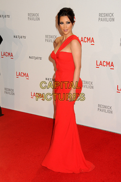 "KIM KARDASHIAN .at LACMA's ""The Unmasking"" The Lynda & Stewart Resnick Exhibition Pavilion Opening Gala at The Los Angeles County Museum of Art in Los Angeles, California, USA, September 25th 2010..full length long maxi dress red one strap  shoulder .CAP/ADM/BP.©Byron Purvis/AdMedia/Capital Pictures."