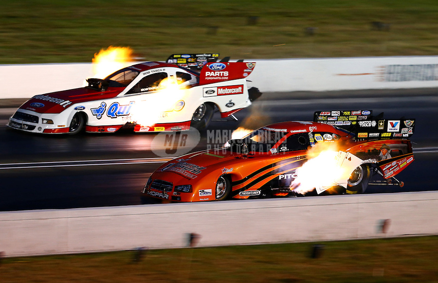 Aug. 31, 2013; Clermont, IN, USA: NHRA funny car driver Johnny Gray (near lane) races alongside Bob Tasca III during qualifying for the US Nationals at Lucas Oil Raceway. Mandatory Credit: Mark J. Rebilas-