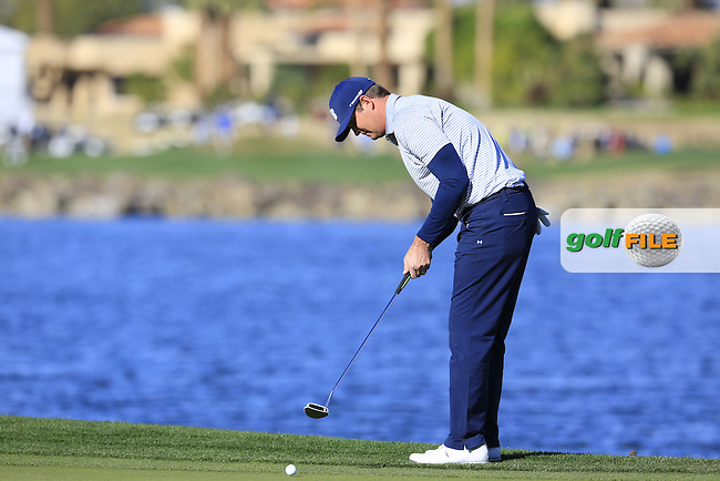 Hudson Swafford (USA) putts on the 18th green during Saturday's Round 3 of the 2017 CareerBuilder Challenge held at PGA West, La Quinta, Palm Springs, California, USA.<br /> 21st January 2017.<br /> Picture: Eoin Clarke | Golffile<br /> <br /> <br /> All photos usage must carry mandatory copyright credit (&copy; Golffile | Eoin Clarke)