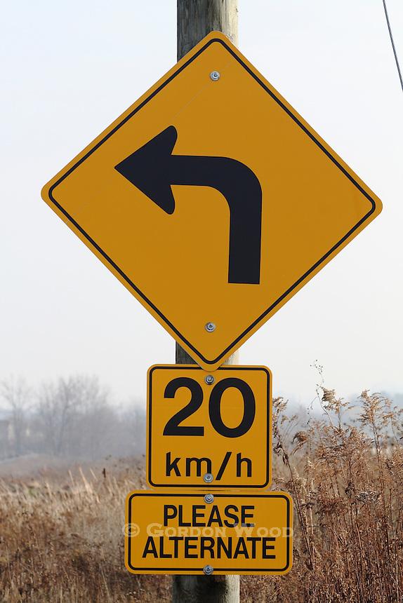 Left Curve Sign near Entrance to Narrow Bridge