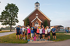 August 15, 2017; On Day 2 of the ND Trail, pilgrims stop for a photo while making the 39 mile trek, 18 walking and 21 biking on the ND Trail from Oaktown to Pimento, Indiana. As part of the University's 175th anniversary celebration, the Notre Dame Trail will commemorate Father Sorin and the Holy Cross Brothers' journey. A small group of pilgrims will make the entire 300+ mile journey from Vincennes to Notre Dame over  two weeks. (Photo by Barbara Johnston/University of Notre Dame)