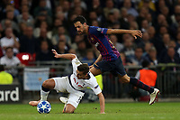 Harry Winks of Tottenham Hotspur and Sergio Busquets of FC Barcelona during Tottenham Hotspur vs FC Barcelona, UEFA Champions League Football at Wembley Stadium on 3rd October 2018
