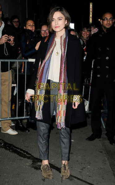 "KEIRA KNIGHTLEY .Seen leaving after the evening performance of ""The Children's Hour"", The Comedy Theatre, London, England, UK, February 8th 2011..full length black coat scarf gold necklace patchwork green pink blue gold grey gray trousers lace up flats shoes brogues .CAP/CAN.©Can Nguyen/Capital Pictures."