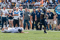 Pitt kickoff return by Quadree Henderson leaves Penn State kicker Joey Julius flat on his face. The Pitt Panthers defeated the Penn State Nittany Lions 42-39 at Heinz Field, Pittsburgh, Pennsylvania on September 10, 2016.