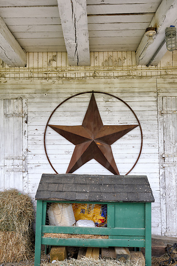 Under the overhang of this whitewashed cantilevered barn sits an unused rabbit hutch full of stuff, some hay, and a very large circled metal barn star on the wall, all of which makes for an interesting Americana scene taken on a working farm. The title came to mind thinking of the stable manger in Bethlehem with the star above whose light led the wise men onward. This was taken during a day-long nine barn tour in Maryland on one of the hottest days in June that I could recall, but it was fun and enjoyable because all of the barns were out through a very beautiful lay of scenic farmland near Frederick.<br /> <br /> Monthly Newsletter sign up at Dierks Photo on Facebook...