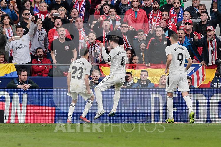 Real Madrid's (L-R) Sergio Reguilon, Sergio Ramos and Karim Benzema celebrate goal during La Liga match between Atletico de Madrid and Real Madrid at Wanda Metropolitano Stadium in Madrid, Spain. February 09, 2019. (ALTERPHOTOS/A. Perez Meca)