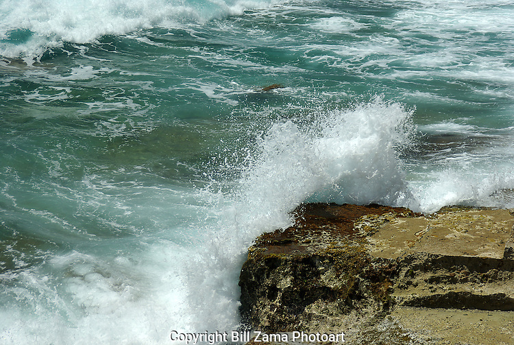 Waves crashing on coastal rocks in Bermuda.