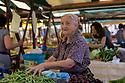 Woman selling vegetables on a market stall, Zadar, Croatia.