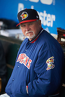 Toledo Mudhens manager Larry Parrish (15) in the dugout before a game against the Rochester Red Wings on May 12, 2015 at Frontier Field in Rochester, New York.  Toledo defeated Rochester 8-0.  (Mike Janes/Four Seam Images)