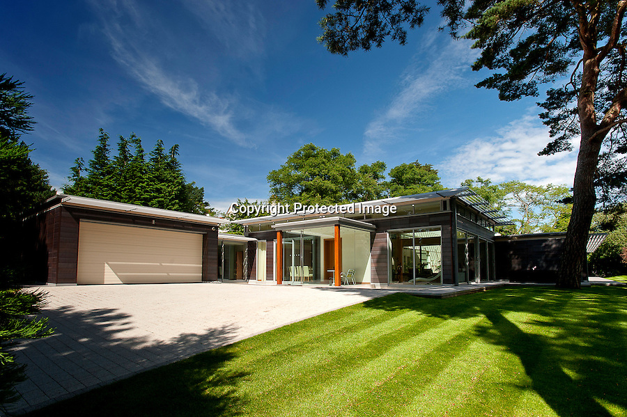 BNPS.co.uk (01202 558833)<br /> Pic: Savills/BNPS<br /> <br /> Award winning house - Yors for £3.3million.<br /> <br /> A luxury retreat once voted the Daily Mail's house of the year has hit the market with a price tag of 3.3 million pounds.<br /> <br /> The plush three-bedroom property boasts a range of mod cons including a swimming pool, a gym, underfloor heating and solar panelling across 6,000 sq ft.<br /> <br /> Built in 2009, the single storey house's enormous 1,200 sq ft open-plan living room is bigger than an average three bedroom apartment.<br /> <br /> Located in the well-heeled area of Branksome Park in Poole, Dorset, it even has two fully-equipped kitchens - one for day-to-day cooking and the other for entertaining.