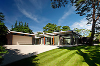 BNPS.co.uk (01202 558833)<br /> Pic: Savills/BNPS<br /> <br /> Award winning house - Yors for &pound;3.3million.<br /> <br /> A luxury retreat once voted the Daily Mail's house of the year has hit the market with a price tag of 3.3 million pounds.<br /> <br /> The plush three-bedroom property boasts a range of mod cons including a swimming pool, a gym, underfloor heating and solar panelling across 6,000 sq ft.<br /> <br /> Built in 2009, the single storey house's enormous 1,200 sq ft open-plan living room is bigger than an average three bedroom apartment.<br /> <br /> Located in the well-heeled area of Branksome Park in Poole, Dorset, it even has two fully-equipped kitchens - one for day-to-day cooking and the other for entertaining.