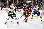 ST PAUL, MN - APRIL 7: Andrew Peeke #22 of the Notre Dame Fighting Irish tries to control the puck during the Division I Men's Ice Hockey Championship held at the Xcel Energy Center on April 7, 2018 in St Paul, Minnesota. (Photo by Tim Nwachukwu/NCAA Photos via Getty Images)