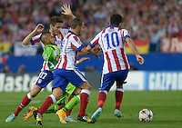 MADRID (SPAIN), OCTOBER, 1, 2014. Arda Turan, Koke and Cristian Ansaldi of Atlético de Madrid fight for the ball with Arturo Vidal of Juventus de Turín during the football match of Atlético de Madrid vs Juventus de Turín at Vicente Calderóne stadium for UEFA Champions League. PATRICIO REALPE/ASNERP