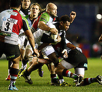 Photo: Richard Lane/Richard Lane Photography. Harlequins v Stade Toulouse. Heineken Cup. 09/12/2011. Toulouse's Timoci Matanavou is tackled by Quins' George Robson.