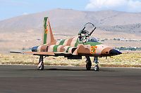 A U.S. Navy F-5 Tiger from VFC-13 based out of NAS Fallon moves along the taxiway at Stead Field, Nevada in September 2007. On June 13, 2008 a F-5 Tiger from VFC-13 collided with an F-18C Hornet while on a routine training mission. The two pilots in the F-5 ejected safely and was picked up 50 miles east of the Naval Air Station in Fallon, Nevada while the F-18 pilot was killed in the collision. Photographed 09/07